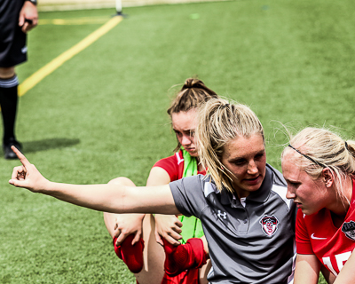 Female Coach working with player